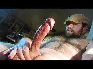 Bear shoots his load on his hairy tummy