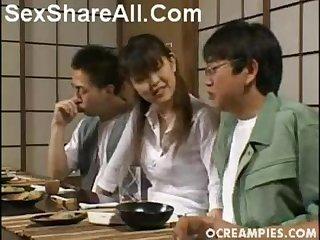 Asian girl masturbates 2 guys under a table