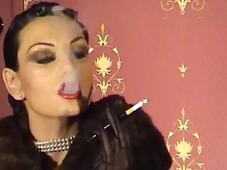 Fur mistress smoking