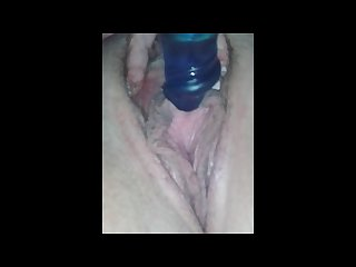 Wife masturbates with sex toy and squirts a little