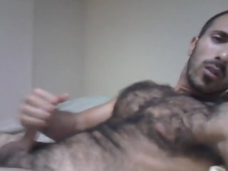 Beefy guy shoots on hairy Chest