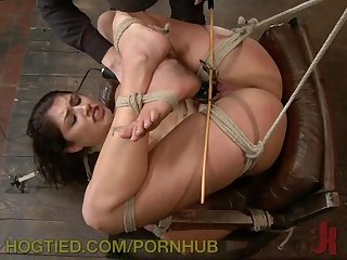 Pretty princess is hogtied and suspended upsidedown