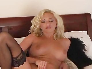 Busty babe satisfies herself