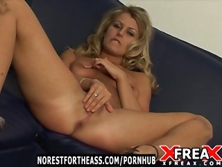 Blonde striptease and masturbates