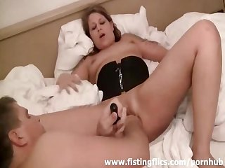 Busty blond milf fisted in her loose vagina