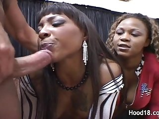 Two black MILFs sharing a white cock
