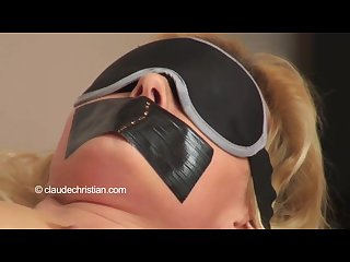 Tape gagged blindfolded bondage