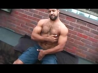 Muscle cub roman wright jerks off on rooftop