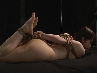 Naked and hogtied
