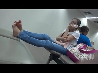 Candid feet relaxing thai girl