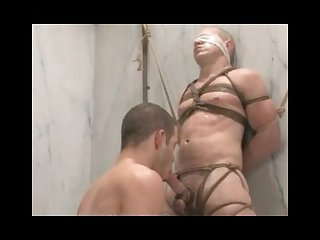 Wolf hudson gives christian owen a hard bondage fuck in the shower