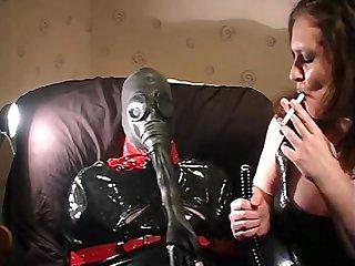 Mistress smoking breath control