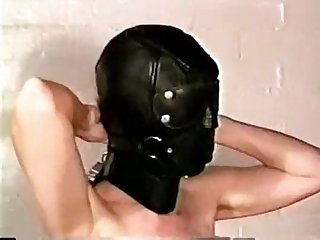 Woman self hooding in black leather