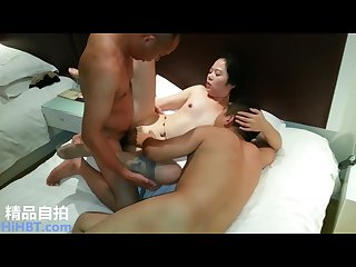 Chinese milf fucked in a hotel by three guys