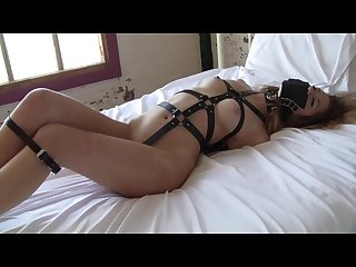 Sheeba collins struggling in armbinder on bed