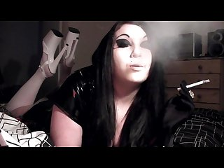 Princess Smoke financial domme smoking in platform heels