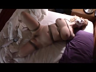Busty milf bound on bed and vibed