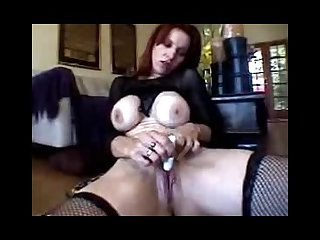 Red head gives herself intense orgasm