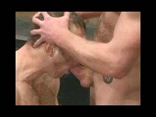 Two studs with big dicks fight naked in oil and the winner fucks the loser