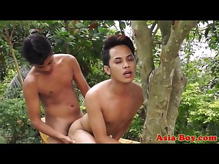 Young asian twink bareback banged outdoors following blowjob