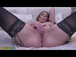 Brunette mom masturbating on the bed