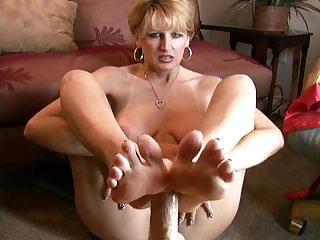 Milf gives guy a footjob