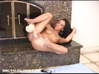 Hot brunette judy star fucks a big brutal dildo