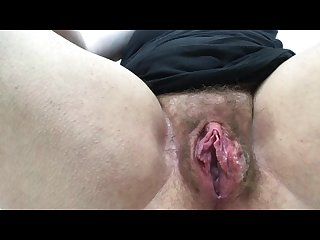 Wet from watching porn so fingering hairy meaty pussy to orgasm