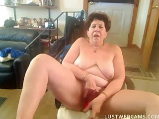 Nasty granny lady toying her pussy and ass with a dildo in front of webcam