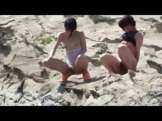 Japanese girls pissing by a river