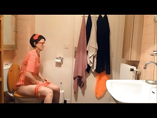 Sexy shy Retro girl is taking shit and piss