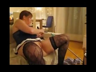 Hot mature wife plays with dildo and watching porn