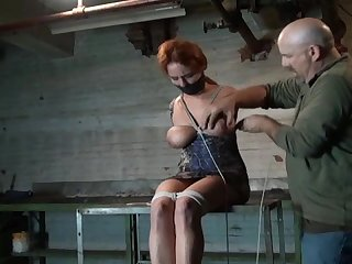 Captive bound to table and nipple tortured