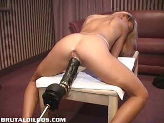 Petite french blonde demolished by a brutal dildo machine