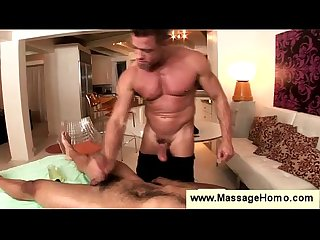 Gay masseur puts on a comdom to fuck