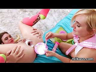 Hot lesbos fill up their massive asses with milk and burst it out
