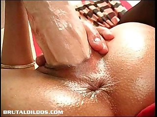 Ella s tight pussy lips grip onto a giant brutal dildo