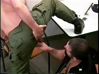 Manly cop fucks a horny gay stud in his office