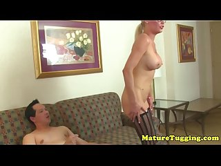 Spex milf with bigtits in stockings giving hj