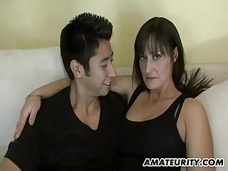 Hot amateur Milf sucks and fucks a young cock