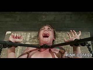 Struggling girl overpowered suspended bound