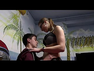 Busty mom teaching a very young boy