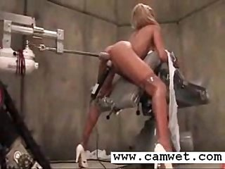 Hot blonde riding her pussy on toy machine