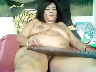 Sexy belly Z.A. mature model with tattoos