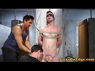 BDSM sub restrained for tugging and tickling