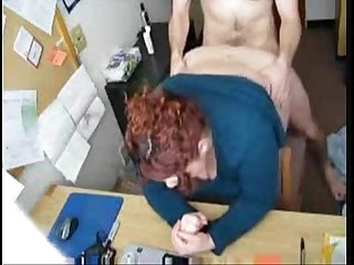 Fat redhead fucked in office