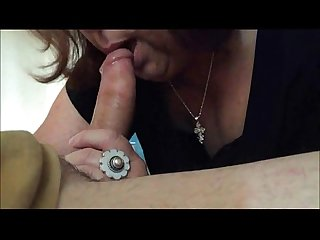 Brunette grandma sucks a young cock