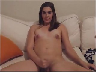 Shemale brings her big cock to orgasm