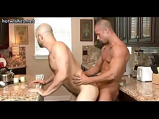 Gay taking a cock in his ass in the kitchen