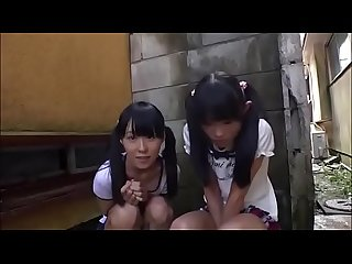 Two petite japanese girls sucking a dick